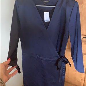 Blue romper w shorts. Wrap style brand w tag
